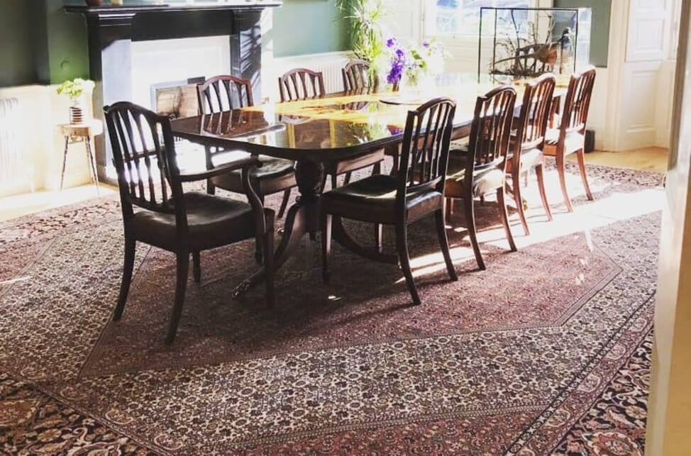 Oriental Carpet Underneath A Dining, Rug Under Dining Room Table